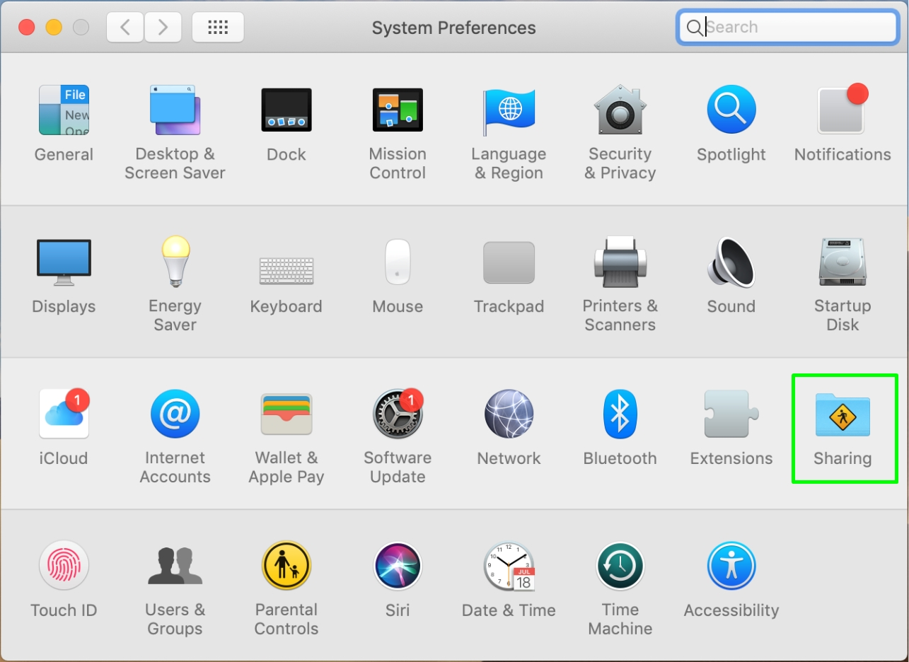 The Sharing icon is selected within the Mac System Preferences